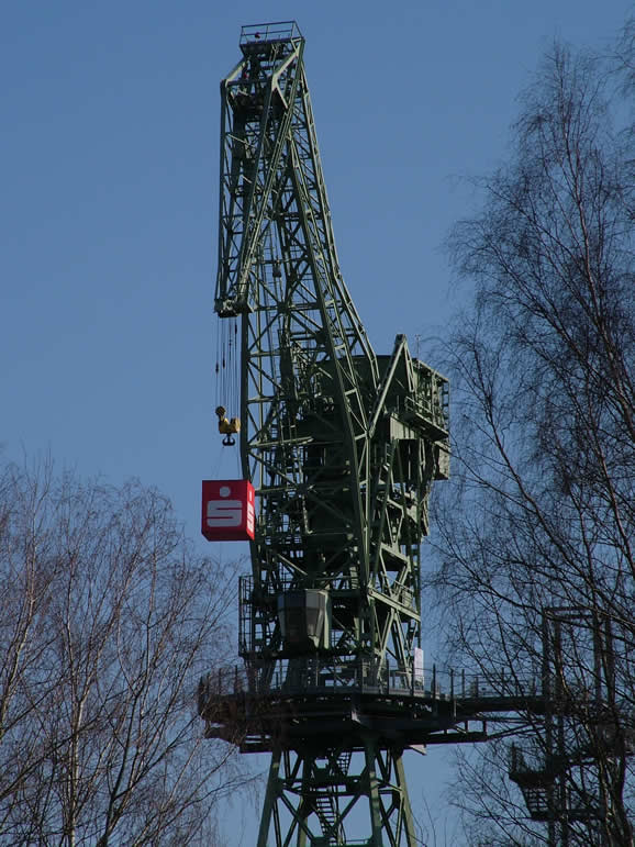 Photo: Old crane and advertising